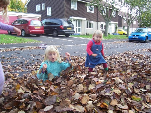 Kate and Lily in leaves