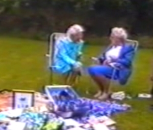 In this screenshot from family video, Gran Nichol and Gran Trasler chat at Eldest Weasel's Christening party.