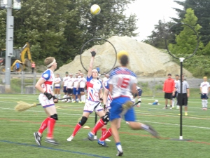 A GB player attempts to defend the goal from another determined US attack.